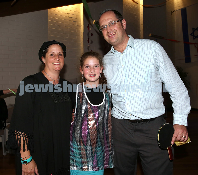 North Shore Synagogue's Youth Chanukah Party. Rabbi Paul Lewin with his wife Talya and daughter Dania.