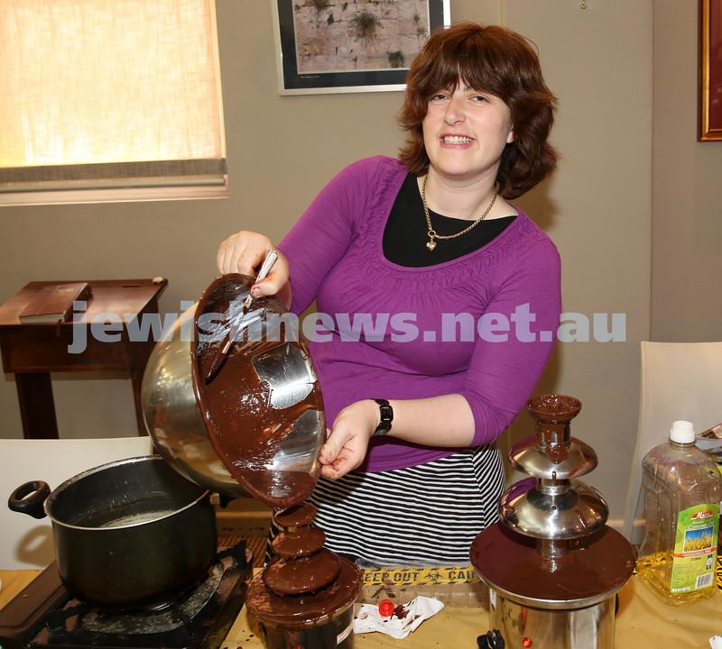 Nefesh Chanukah Party. Sarah Chana Sufrin filling the chocolate fountain.