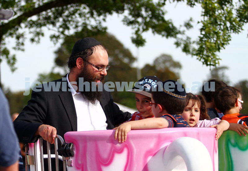 1-12-13.  Chanukah in the Park  2013 at Melbourne's Caulfield Park. Enjoying the spinning cup ride. Photo: Peter Haskin