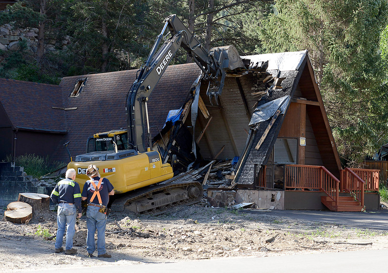 Kennie Andersen, left, and Harry Fiechtner watch as the Interlude Chapel is demolished Wednesday, July 13, 2016, in Drake. The chapel was damaged by the flood in 2013 and then repaired. In March it was damaged by a fire and now has to be demolished and rebuilt to code. (Photo by Jenny Sparks/Loveland Reporter-Herald)