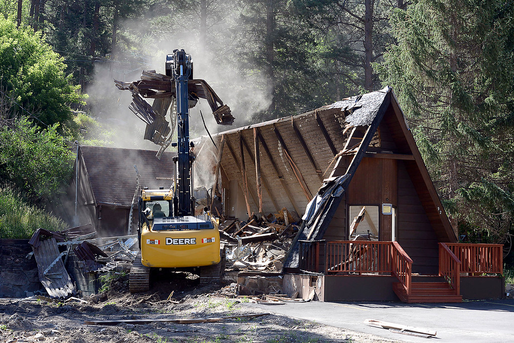 . Scott Haney with Agritrack, Inc. uses an excavator to demolish the Interlude Chapel Wednesday, July 13, 2016, in Drake. The chapel was damaged by the flood in 2013 and then repaired. In March it was damaged by a fire and now has to be demolished and rebuilt to code. (Photo by Jenny Sparks/Loveland Reporter-Herald)