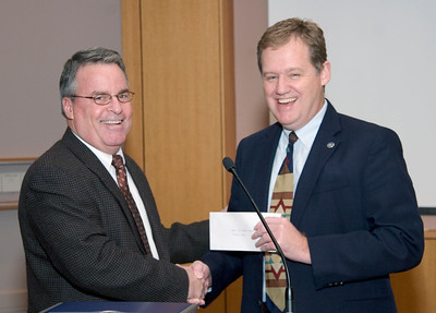 Chapel Hill Public Library Foundation President Gene Pease presents Mayor Kevin Foy with a check for $50,000, Dec 4, 2006