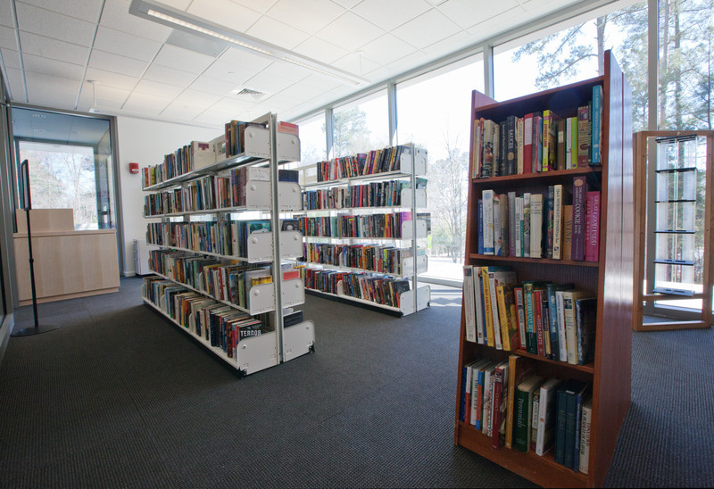 View from the back inside corner of the Book Store.  The Store's wood checkout desk can be seen to the left.  The Store's outside glass wall is at the far side of the photo, center to right.