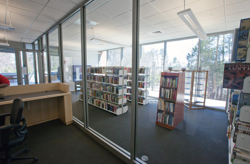 View from outside the Book Store.  Both long walls of the Store are all glass.  The Library's lower entrance checkout desk is to the left.