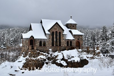 Chapel on the rock, in the snow