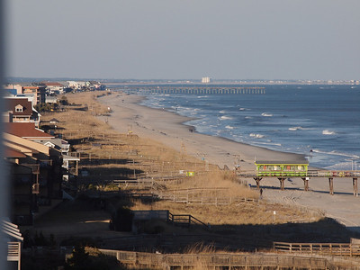 Looking north from our balcony toward the Carolina Beach pier and Wilmington