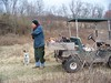Dave Hellums and his dog Buddy at Banshee Reeks Nature Preserve, assisting with invasive species removal.