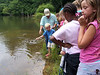 Feeding fish at Beagle Ridge Salvation Army program with 72 kids.