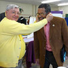 Clyde Marsteller lets Dr. McKinley Price, Mayor of Newport News, listen to Betsy Beetles.