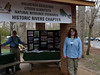 HRCVMN VOLUNTEER SERVICE:  Mike and Susan Powell staff the Historic Rivers exhibit at New Quarter Park near Williamsburg.