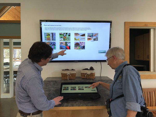 Showing off the kiosk that HRC volunteers helped create at Freedom Park.