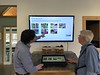 Showing off the kiosk that HRC members helped create for Freedom Park.