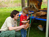 DGIF employee John Rohm helps young sightless girl experience the wildlife collection at the Merrimac Farm Bluebell Festival 2012.