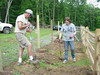 Master Naturalist Jack Noll works with Virginia Tech student volunteer Revonda Pokrzywa to prepare a flower bed for planting.    <br /> Photo by Barb Walker