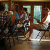 Participants read informational printouts during training for the NABA Butterfly Count at Ivy Creek Natural Area. June 20, 2012. Photo by Rachel Wallace.