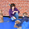 RMN Volunteer Eileen Decamp working with a young attendee on the Cypress Knee vertical puzzle.