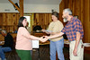 Class 4 members receive their graduation certificates from President Susan Pleiss and curriculum committee chair Tony Russell.