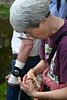 Ruth Douglas observes a millipede at the New Chapter Coordinators Training, May 2006, at Douthat State Park.