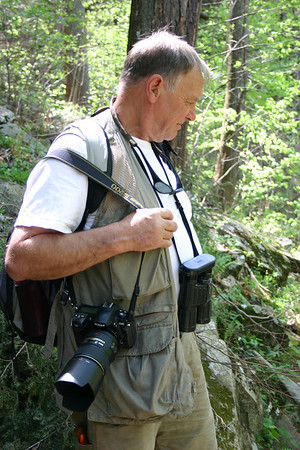 Peter Dutnell checking out the flora around him. (Photo by Michelle Prysby)