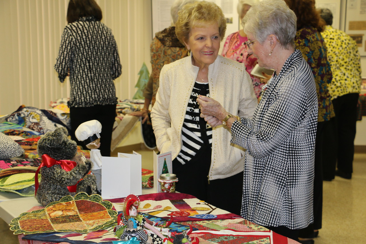 Members gather in conversation at NG Table displays