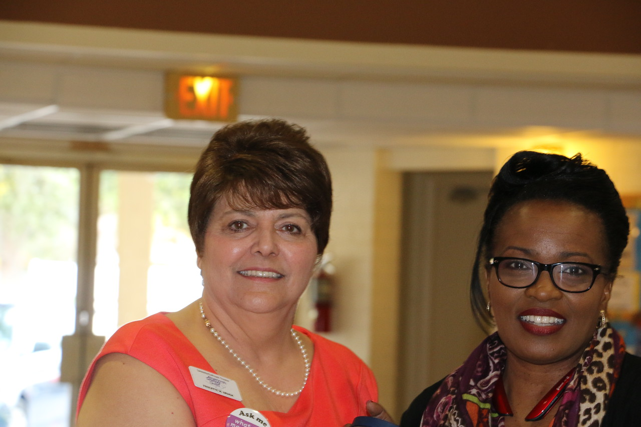Paulette thanks Rose Smith for all her hard work in arranging for us to have 21 Babylock sewing machines for ASG youth educational programs in our community.