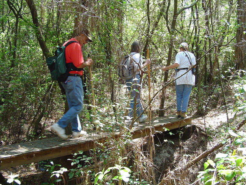Hikers crossing bridge on Econfina Trail<br /> Sue Wiles / FTA