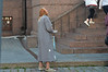 Woman begging outside the church in Estonia.