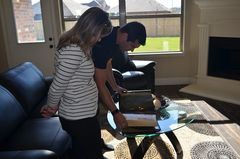 Altura Homes also gave the family a photo album filled with photos capturing their experiences receiving this home.