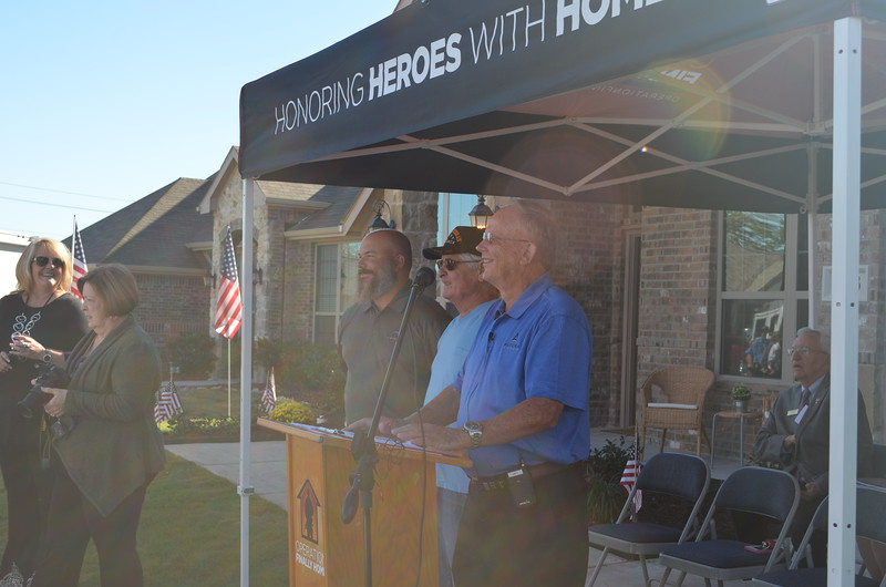 Justin Webb of Altura Homes, George Dierking, Post Commander of the American Legion Post 17, Greenville, Texas, and Donnie Evans of Altura Homes.