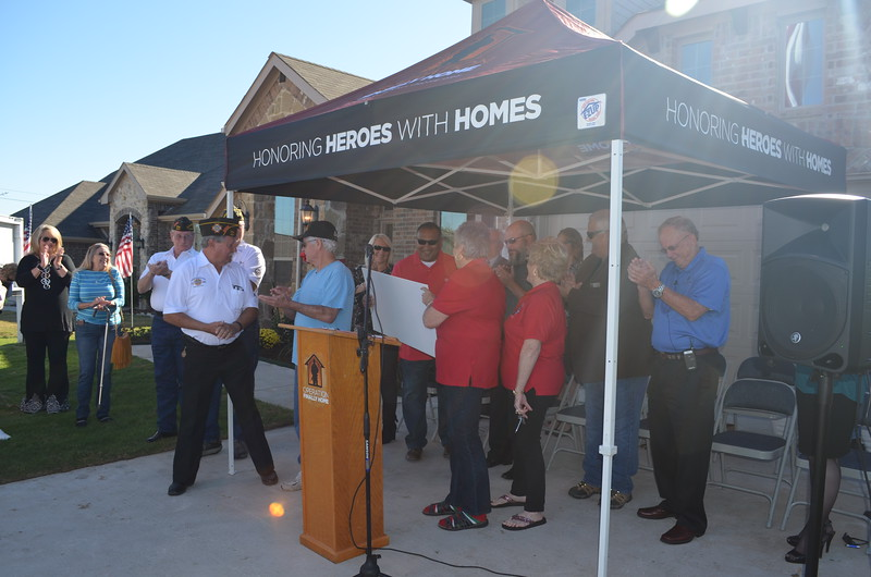 Becky Crabtree of Elks Lodge presented Sgt. Rivas with a check for $2,000 to be used in furnishing his new home.
