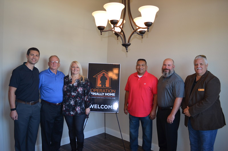 Phil Crone of the Dallas Builders Association, Donnie Evans of Altura Homes, Donnajayne Rivas, Guillermo Rivas, Justin Webb of Altura Homes and Ronnie Lyles of Operation FINALLY HOME.