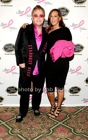 Elton John, Donna Karan<br /> photo by Rob Rich © 2010 robwayne1@aol.com 516-676-3939