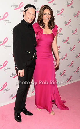Johnny Weir, Elizabeth Hurley<br /> photo by Rob Rich © 2010 robwayne1@aol.com 516-676-3939