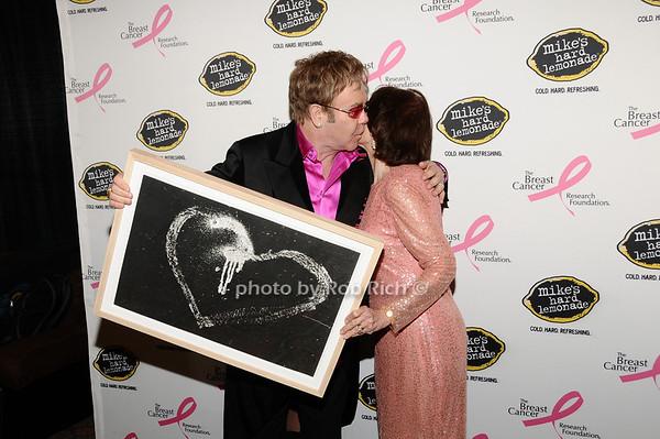 Elton John, Evelyn Lauder<br /> photo by Rob Rich © 2010 robwayne1@aol.com 516-676-3939