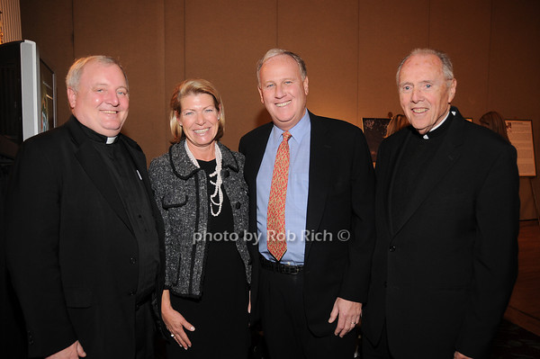 Father West, Helen Fell, Keith Fell, Monsignor Fagan<br /> photo by Rob Rich © 2009 robwayne1@aol.com 516-676-3939