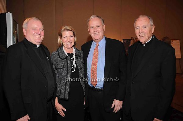 Father West, Helen Fell, Keith Fell, Monsignor Fagan<br /> photo by Rob Rich © 2009 robwayne1@aol.com 516-676-3939