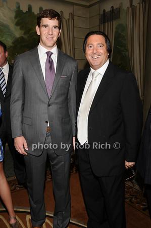 Eli Manning, Larry Wohl<br /> photo by Rob Rich © 2010 516-676-3939 robwayne1@aol.com