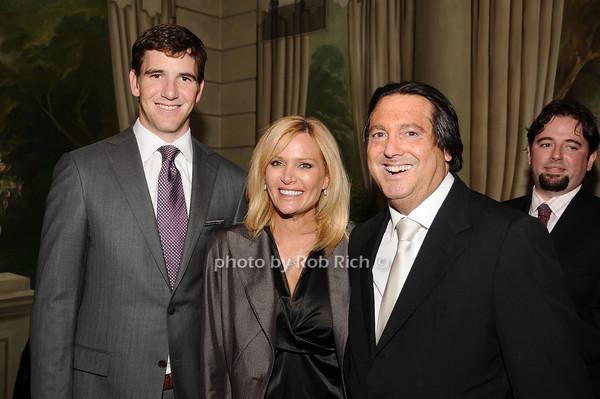 Eli Manning, Leesa Rowland, Larry Wohl<br /> photo by Rob Rich © 2010 516-676-3939 robwayne1@aol.com