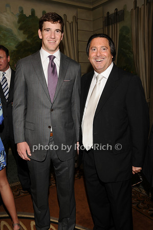 Eli Manning, Larry Wohl<br /> photo by Rob Rich © 2010 516-676-3939 robwayne1@aol.com