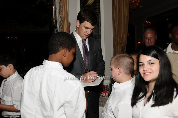 Eli Manning, members of the Little Flower Glee Club