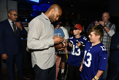 David Tyree signing a helmet photo by Rob Rich/SocietyAllure.com ©2017 robrich101@gmail.com 516-676-3939