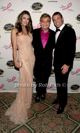 Elizabeth Hurley, Elton John, and Shane Warne photo by Rob Rich/SocietyAllure.com © 2012 robwayne1@aol.com 516-676-3939