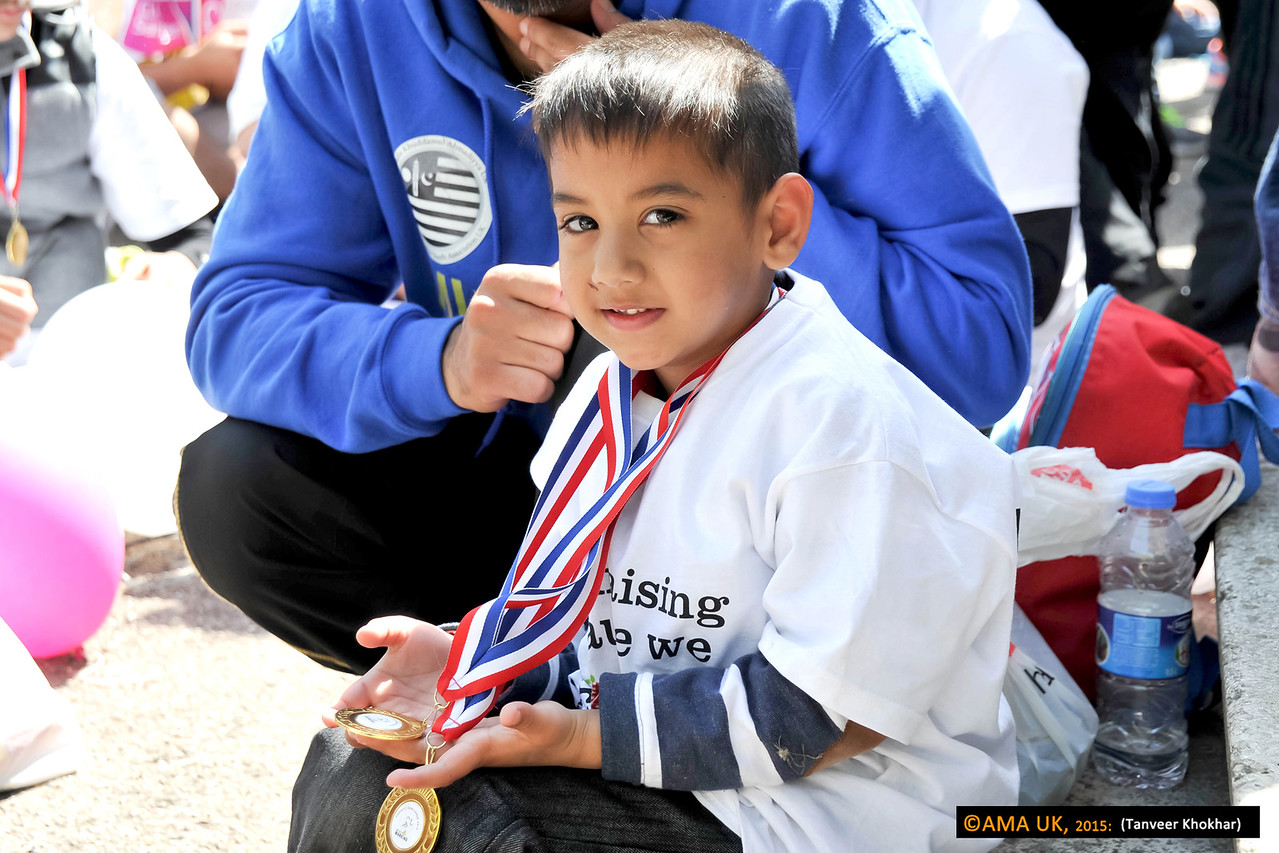 A young walker who completed his course with his medals for achievement. Well done!!