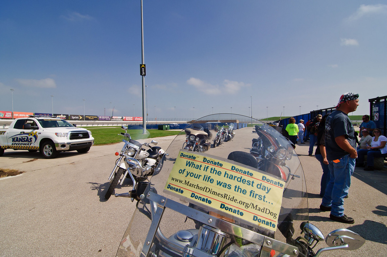 1355 - northwest corner of infield - a sign on another of the Grand Donor bikes.
