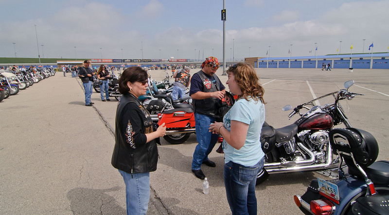 1250 - lot between garages A and B - Penny talking to participants just in from the ride.