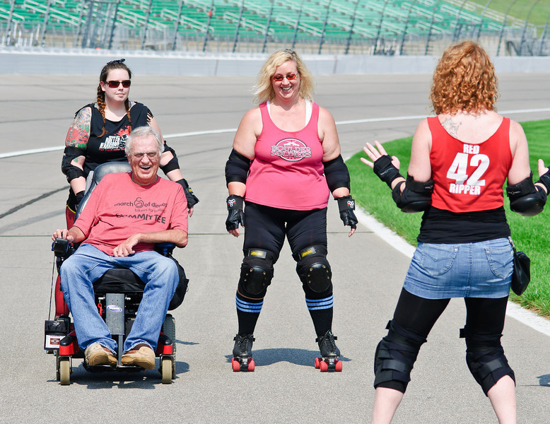 1404 - front stretch of track - Don Post longtime Bikers for Babies supporter and volunteer with the group of roller derby girls who helped him raise money for this years event.