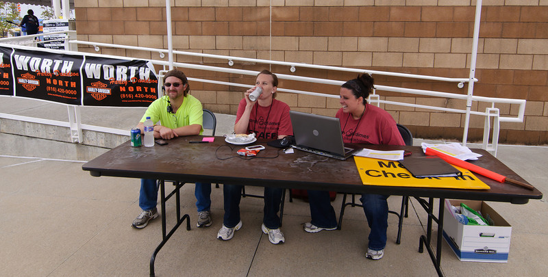 1151 - north side of Media Center - Event staff and a HAM volunteer at the information table.