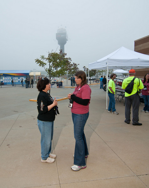 0812 - just outside the Media Center - Penny meeting with a March of Dimes staff member. The fog is still trying to hang around, as can be seen by the tower in the background.