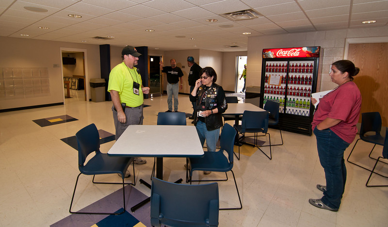 1100 - Media Center - most of the bikes are gone and the VIP breakfast area has been taken down. Matt, Penny and Kara have a brief discussion. In the background is Ed and a member of his Posse.