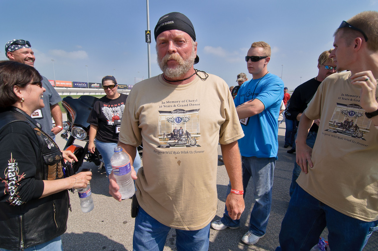 1356 - northwest corner of infield - a Grand Donor proudly displays his shirt dedicated to his wife and the Bikers for Babies event that she cared so much about.